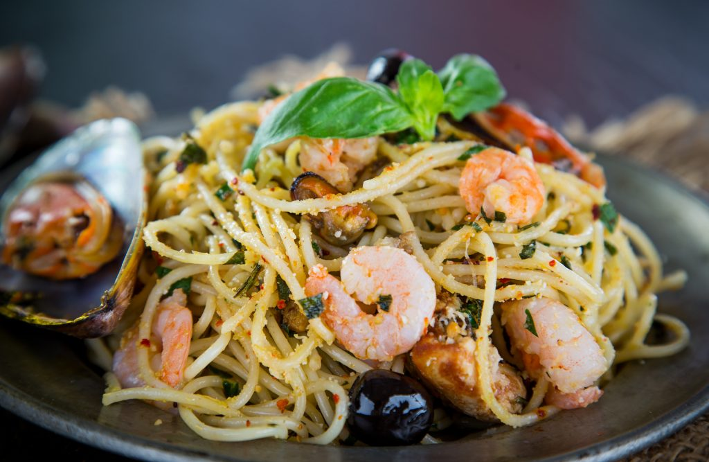 Italian pasta aglio olio with sea fruit