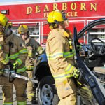 """Dearborn firefighters use powerful new Jaws of Life style rescue equipment to dismantle a vehicle during a training exercise on Dec. 9. With nearly twice the strength of older Jaws of Life, the Res Q Tec is more effective in cutting through the stronger steel used in current model vehicles. The City of Dearborn purchased the equipment using a $97,000 """"Assistance to Firefighters"""" grant from the Federal Emergency Management Agency. Ford Motor Company donated 12 late-model cars and trucks so that all 120 Dearborn firefighters can train to use the rescue equipment to dismantle vehicles with ultra strong steel."""