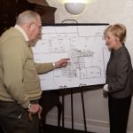 Oakwood Common resident George Stevens talks with Mary Granata, manager of sales, about one of the new activity and social areas to be renovated by early spring.