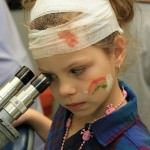 Natalie Neville looks at a smear in a microscope.
