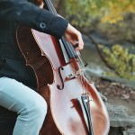 A cello student practices at the Henry Ford estate by the Rouge River