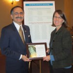 Representative George T. Darany receives plaque from Cyndi Roper