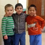 Pictured outside a classroom at Dearborn Heights Montessori Center are three friends, from left, Isaac Perkins, age 3, Luis Rodriguez, age 3, and Michael Lu, age 5.