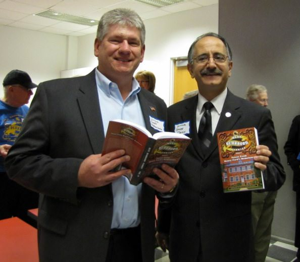 Gary Woronchak and George Darany hold copies of Best Dearborn Stories Voices from Henry Ford's Home Town Volume 2