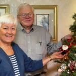New residents Phil and Jane Button admire the Christmas tree decorations at Oakwood Common.