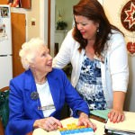 Colleen Stieper shows Geriatric Care Manager Marcia Filek how she organizes her medications.