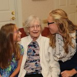 Sue Wright enjoys a lively conversation with granddaughters, Ella Wright, at left, and Savannah Wright.