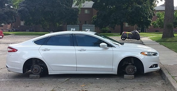 Four wheels are missing from a car in the Oxford Apartment  complex near Monroe and Outer Drive.