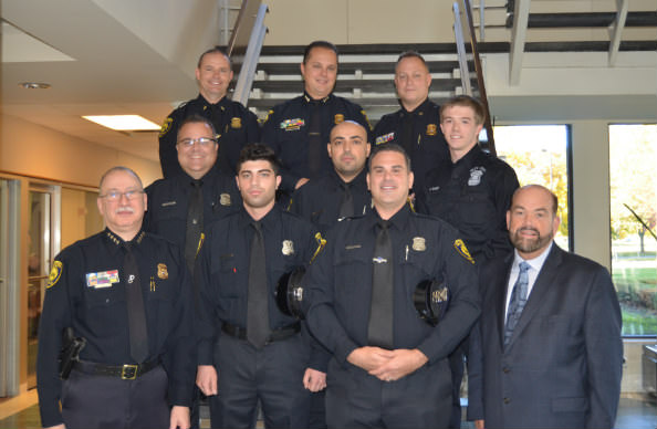 Shown here are (front row, from left): Chief Ronald Haddad, Hashin Zrien, Michael Hammoud and Mayor John B. O'Reilly, Jr. (Middle row, from left): Christopher Salisbury, Samir Nasser and Police Intern Casey Baker. (Back row, from left): Lt. Ronald Beggs, Deputy Chief Thomas Teefey and Patrol  Commander David Robinson. / Photo Courtesy of the City of Dearborn