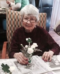 Dolores McHugh shows the St. Patrick's  Day arrangement she made during the Horticultural Therapy workshop