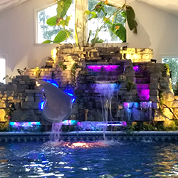 Color Chasing Strip Lights for a Pool Slide & Water Feature