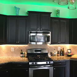 RGB Warm White Strip LIghts Are Used To Light Up Under And Over - Kitchen up lighting