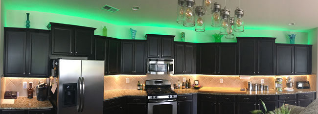 Rgb Warm White Strip Lights Are Used To Light Up Under And Over Kitchen Cabinets