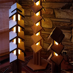 Freestanding Wooden Lamps are lit using Thin LED Strip Lights