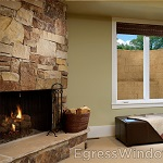 Window well installed outside a cozy basement den, improving natural light and providing easy escape.