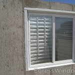 New construction windows installed from the Easy Egress Kit in White.