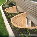 Basement remodeling made easy and code compliant with Elite egress window wells shown in Tan.