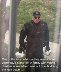 Boston police officer delivering milk