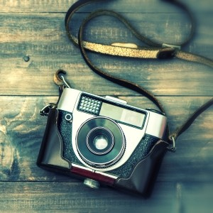 Vintage film camera on wooden background. Instagram style