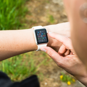 Ostfildern, Germany - April 26, 2015: A middle aged Caucasian woman is checking her Apple Watch displaying the main screen with numerous icons representing the various apps. The Apple Watch is the latest device by computer and smartphone manufacturer Apple Computer and is available since April 24, 2015.