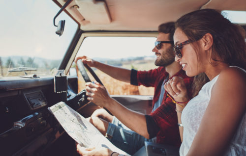 woman reads to man while he is driving car