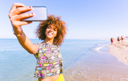 woman taking selfie on beach