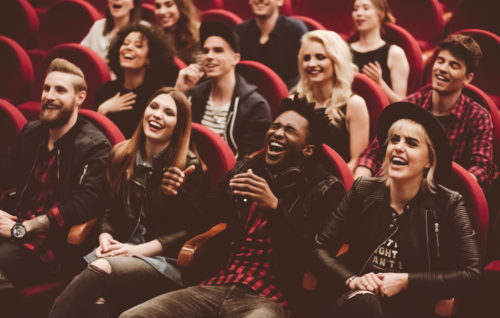 Multi-ethnic group of people in a cinema