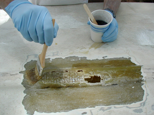 Wetting Fiberglass with Resin