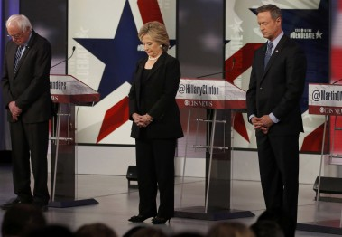 Democratic U.S. presidential candidates Sanders, Clinton and O'Malley hold moment of silence on stage ahead of the second official 2016 U.S. Democratic presidential candidates debate in Des Moines