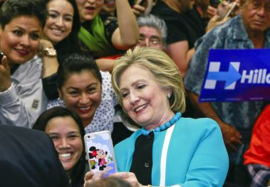Hillary Clinton takes a photo with supporters at the end of a campaign stop at East Los Angeles College in Los Angeles. (AP Photo/Damian Dovarganes)