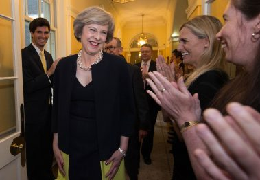 LONDON, UNITED KINGDOM - JULY 13:  New Prime Minister Theresa May, followed by her husband Philip John, is welcomed by staff as she walks into 10 Downing Street after meeting Queen Elizabeth II and accepting her invitation to become Prime Minister and form a new government on July 13, 2016 in London, United Kingdom. Former Home Secretary Theresa May becomes the UK's second female Prime Minister after she was selected unopposed by Conservative MPs to be their new party leader. She is currently MP for Maidenhead. (Photo by Stefan Rousseau - WPA Pool/Getty Images)