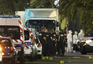 French police forces and forensic officers stand next to a truck that ran into a crowd celebrating the Bastille Day national holiday in Nice. REUTERS/Eric Gaillard