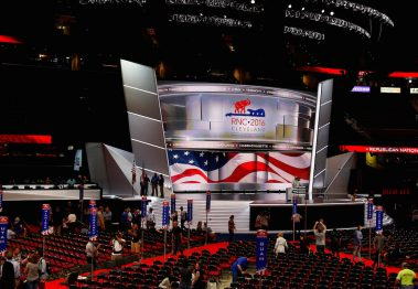 Members of the Committee on Arrangements pose for a photo on the stage at Quicken Loans Arena as setup continues in advance of the Republican National Convention in Cleveland, Ohio, July 16, 2016. REUTERS/Aaron P. Bernstein