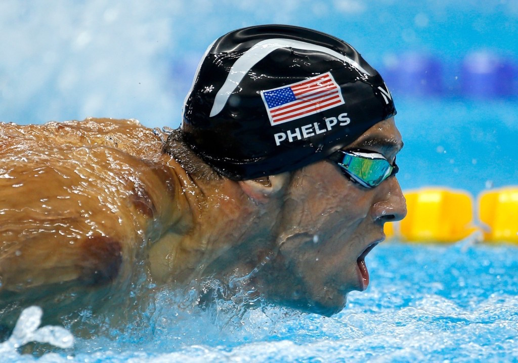 Michael Phelps swims to a gold medal in the men's 200m butterfly. Gary Hershorn/Flipboard