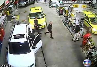 Security video shows three U.S. Olympic swimmers returning to their taxi at a gasoline station where they were accused by staff of having caused damage. Globo TV via Reuters
