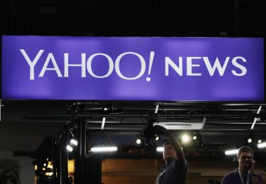 PHILADELPHIA, PA - JULY 25: A Yahoo! News sign is displayed prior to the start of the first day of the Democratic National Convention at the Wells Fargo Center, July 25, 2016 in Philadelphia, Pennsylvania. An estimated 50,000 people are expected in Philadelphia, including hundreds of protesters and members of the media. The four-day Democratic National Convention kicked off July 25. (Photo by Alex Wong/Getty Images)