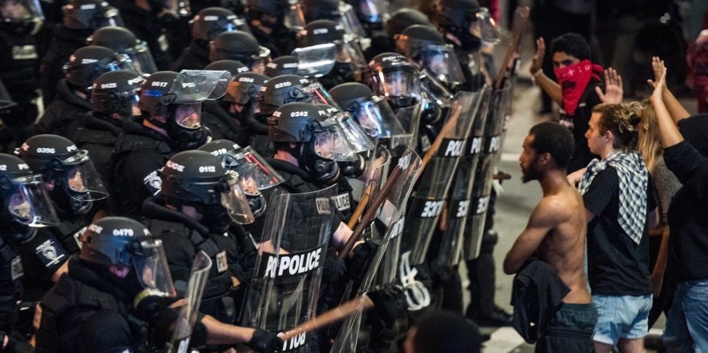 Police officers in riot gear approach demonstrators in downtown Charlotte. Sean Rayford/Getty Images