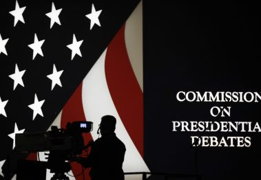 A TV cameraman sets up during rehearsals for the presidential debate between Democratic presidential candidate Hillary Clinton and Republican presidential candidate Donald Trump at Hofstra University in Hempstead, N.Y., Sunday, Sept. 25, 2016. AP Photo/Julio Cortez
