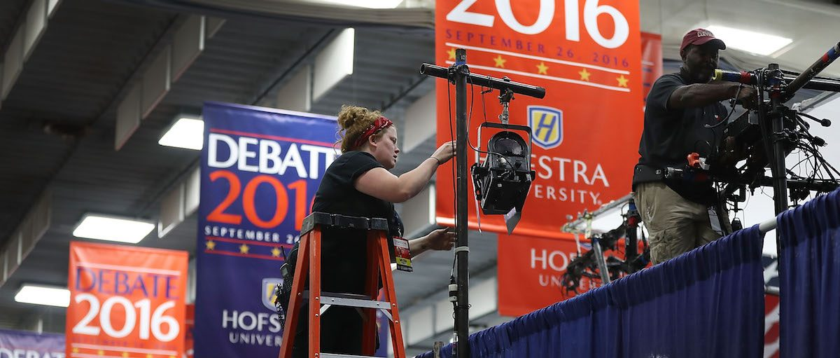 Setting up a television booth in the media center before the first U.S. presidential debate at Hofstra University on September 24, 2016 in Hempstead, New York. Photo by Joe Raedle/Getty Images