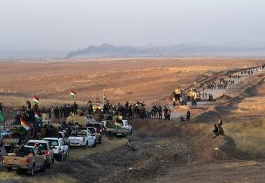 MOSUL, IRAQ - OCTOBER 20:  Kurdish peshmerga forces move forward from an assembly point as they prepare to begin an assault to recapture the village of Tiskharab from ISIS on October 20, 2016 near Mosul, Iraq. Kurdish and Iraqi forces, supported by numerous countries including Britain and the USA, have continued their advance towards towards Iraq's second largest city of Mosul which has been held by Islamic State militants since 2014.  (Photo by Carl Court/Getty Images)
