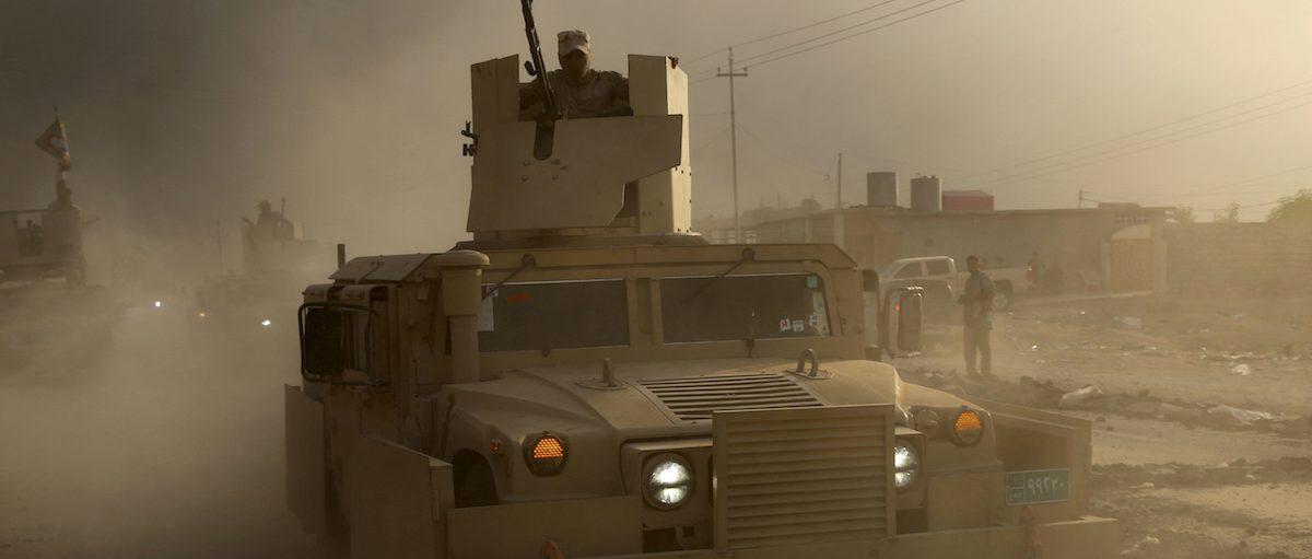 An Iraqi military humvee advances towards the city of Mosul, Iraq, Wednesday, Oct. 19, 2016.  AP Photo