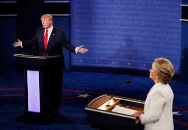 Donald Trump speaks as Hillary Clinton looks on. Pool/Getty Images