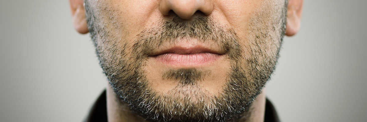 I have a very heavy beard and find that shaving with the grain doesn't give me a close enough shave. What can I do?