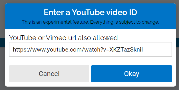 "Paste the YouTube or Vimeo url into the text box and click ""okay""."