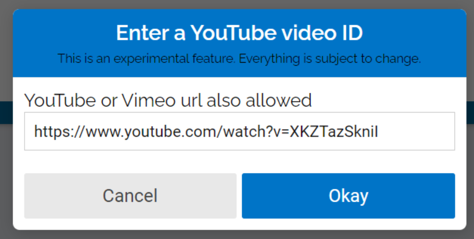 """Paste the YouTube or Vimeo url into the text box and click """"okay""""."""