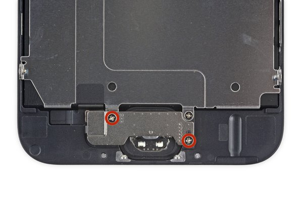 Enlevez les deux vis cruciformes Phillips #00 de 1,9 mm qui attachent le cache du bouton Home.