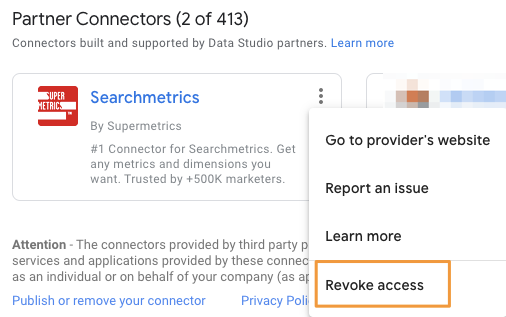 """In the Partner Connectors section of Data Studio, an orange box highlights the option to """"Revoke access"""" from the Searchmetrics by Supermetrics data source"""