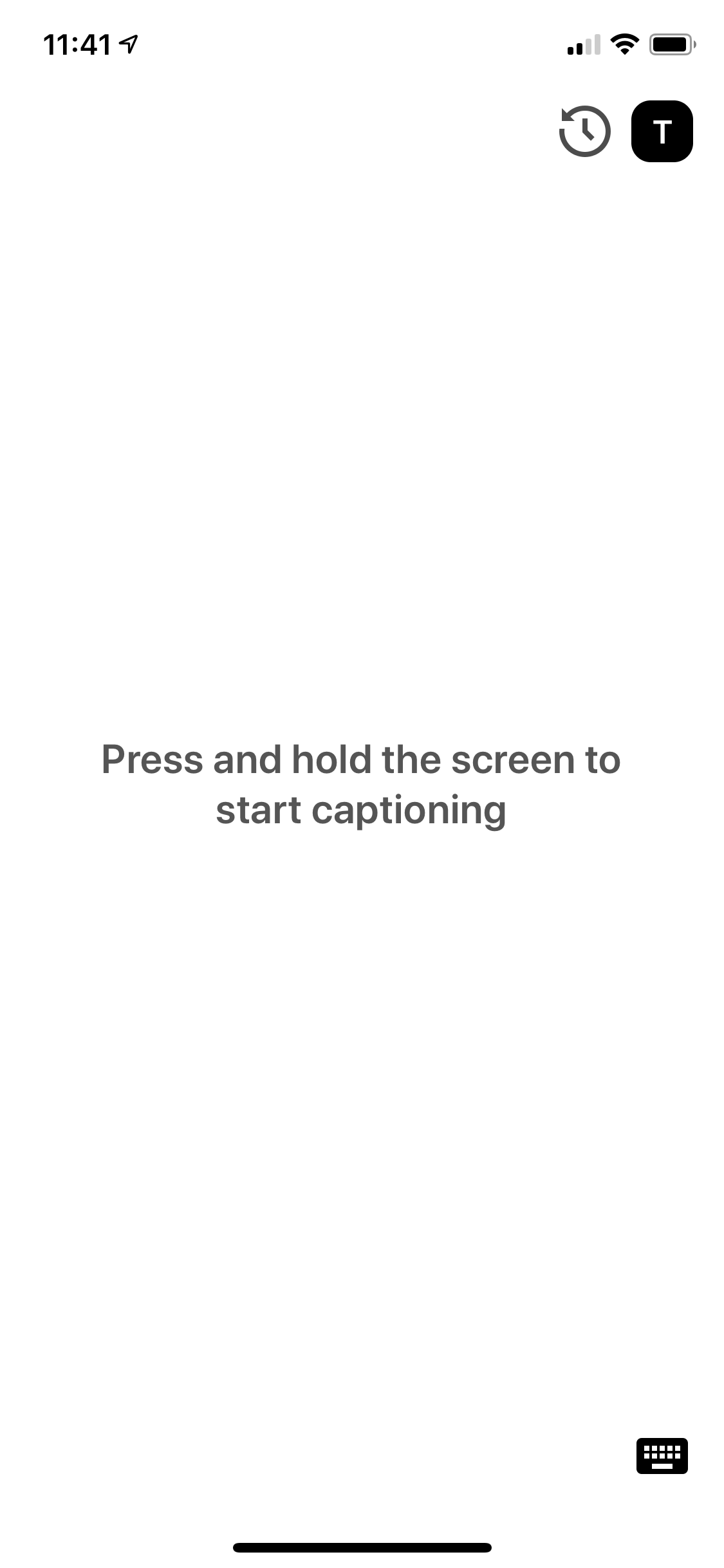 eyeHears captioning interface directly after launch, before anything has been captioned. Contains instructions to press and hold to start captioning.