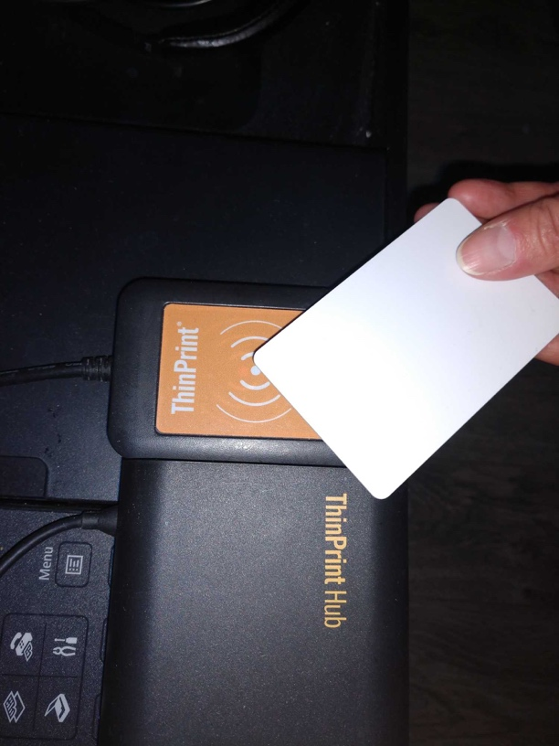 photo: holding an RFID card over a reader