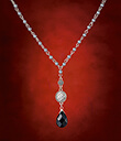 Drop of Black Necklet on Red Background Gaelsong